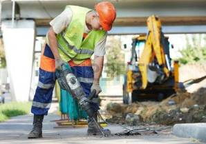 32380529-builder-worker-with-pneumatic-hammer-drill-equipment-breaking-asphalt-at-road-construction-site